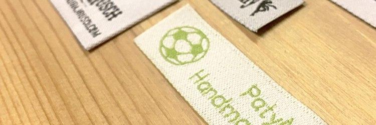 Détails d'étiquettes personnalisées par Garment Printing